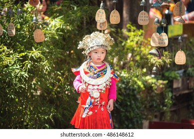 Lijiang,China - March 12,2016 : A girl dressed in ancient Chinese Miao nationality clothing. Located in Lijiang Ancient City, Yunnan Province, China.