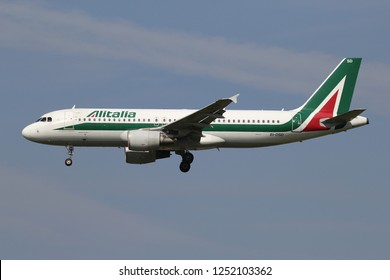 LIJNDEN, THE NETHERLANDS - June 25, 2015: Alitalia Airbus A320-200 with registration EI-DSD on short final for runway 18C of Amsterdam Airport Schiphol.