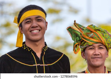 Likas, Kota Kinabalu, Sabah, Malaysia - August 31 2013:  Welcoming contingent of different tribes in their specific traditional costumes at the public celebratation of Sabah's 50. anniversary