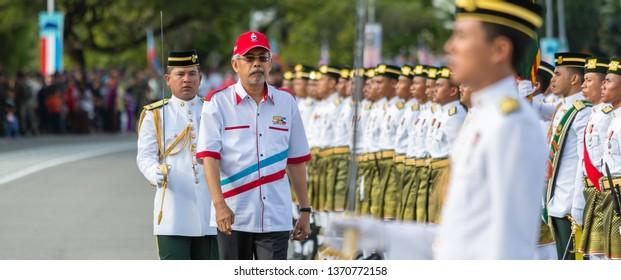 Likas, Kota Kinabalu, Sabah, Malaysia - August 31 2013: Governor Juhar Mahiruddin inspecting Guard of Honour and marching band of the Royal Malay Regiment at the opening celebrations of Hari Merdeka.