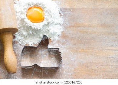 I like baking food concept with thumbs up cookie cutter on wooden background