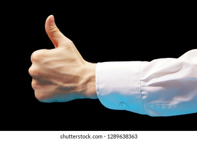 Like. Close up image of human hand with thumb up on black background