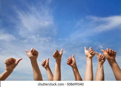 like concept, many hands showing thumb up or ok sign on blue sky background