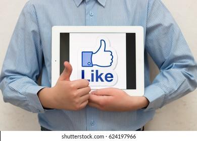 Like. Facebook logo. Brand. IPad Apple. December, 2016 - Minsk, Belarus.