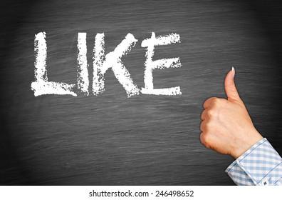 I like it - female hand with thumb up on blackboard background