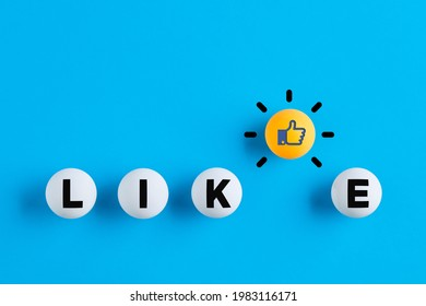 Like icon and the word like written on table tennis balls. Social media interaction, likeability or like us on internet concept.