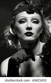 Like a Marlene Dietrich. Woman's retro revival portrait. 30's of the XX century. Professional makeup