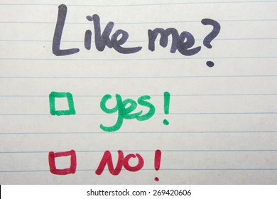 Like me, yes or no written on piece of paper