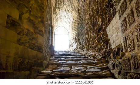 Like a path to the gate of heaven. Sunlight shining at the end of the tunnel. Hope metaphor. After life concept. The exit door of Gaziantep Castle. From darkness to light of life. Staircase to heaven.