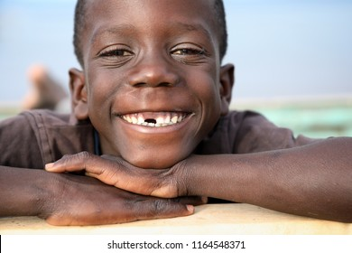 LIKOMA ISLAND, MALAWI - JUNE 17, 2018: Unidentified happy boy smiles on the beach in a village on Likoma Island. Malawi is one of the poorest countries in the world.