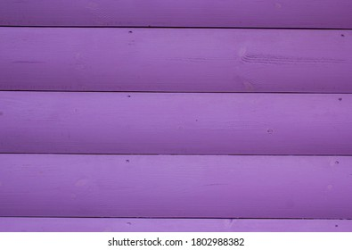 Lilac Background Of Wooden Boards. Texture of pink wooden boards. Light lilac surface of wooden boards, parquet. Wood wall pattern. Light texture of natural wood. Wooden plank boards background.