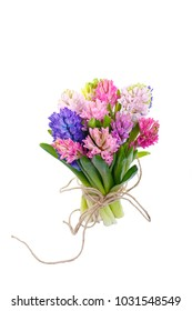 Lilac, blue, pink, raspberry hyacinths in a small, low bouquet, tied with a rope. A holiday, a gift for a woman. Smart. Side view. Isolated