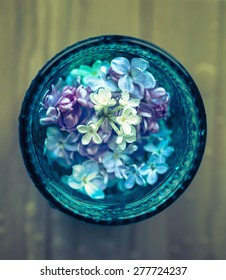 Lilac flowers in glass. Top view