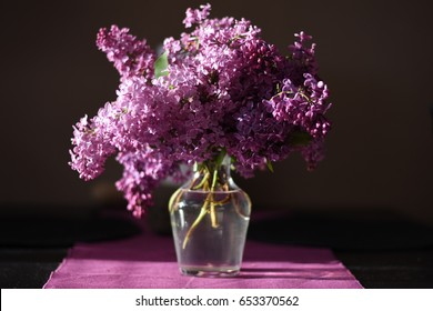Lilac flowers on table. - Shutterstock ID 653370562