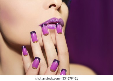 Lilac French manicure for a young woman with purple lips.