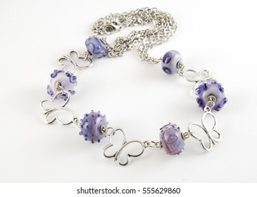 Lilac handmade necklace on white background