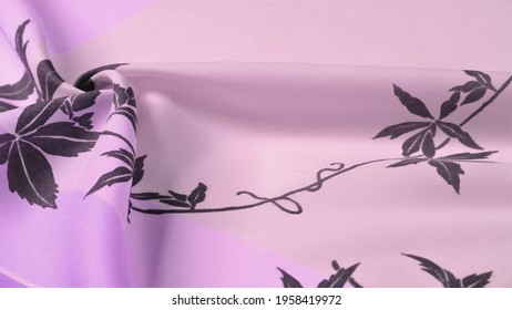 lilac and white silk fabric with a floral pattern. black print, exquisite fabric. Texture, background