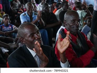 LILIACHI, ZAMBIA - CIRCA 2017 - Two unidentified African men applaud in a church congregation circa 2017 in Liliachi, Zambia.
