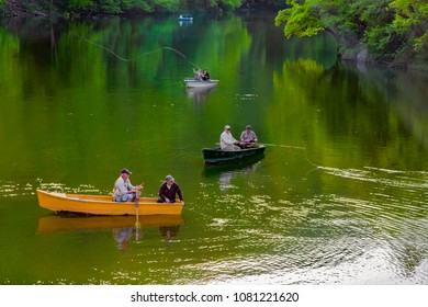 LILLAFURED,HUNGARY - APRIL 28,2018 :Unidentified people fishing on the lake of Lillafured.Lillafured is one of the most beautiful natural environments,near Miskolc,in the Eastern part of Bukk Mountain