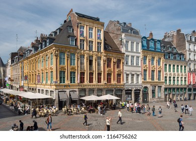 Lille, France - 15 June 2018: Old facades in the place du General de Gaulle Square, also called Grand Place or Main Square.
