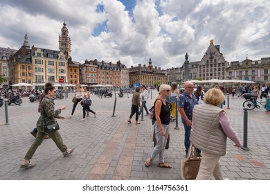 Lille, France - 15 June 2018: People walking in the place du General de Gaulle Square, also called Grand Place or Main Square.