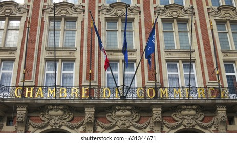 Lille, France - 29 April, 2016: Cobble street walk towards the Place du Théâtre, Chamber of Commerce in Lille old town city center. 29/04/2016.