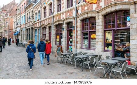 LILLE, FRANCE - APRIL 15, 2017: Rue des Vieux Murs with bars, restaurants and unidentified sightseeing tourists. Rue des Vieux Murs is located in the historical neighbourhood Vieux Lille.