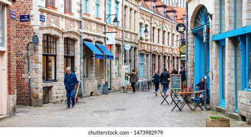 LILLE, FRANCE - APRIL 15, 2017: Panoramic view of Rue des Vieux Murs with bars, restaurants and unidentified tourists. Rue des Vieux Murs is located in the historical neighbourhood Vieux Lille.