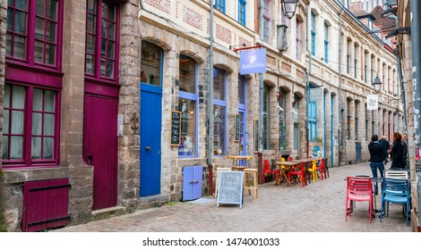 LILLE, FRANCE - APRIL 15, 2017: Rue des Vieux Murs with bars, restaurants and unidentified tourists. Rue des Vieux Murs is located in the historical neighbourhood Vieux Lille.