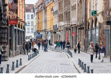 """LILLE, FRANCE - APRIL 15, 2017: unidentified tourists and locals shopping at the """"Rue de la Monnaie"""". It is one of the oldest streets of the city."""