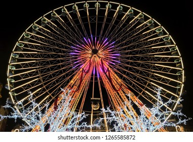 Lille, France – December 22, 2018: A 50-meter high Ferris wheel (La Grande Roue) at the Christmas market gives visitors a stunning view of the city.