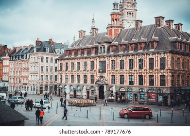 LILLE, FRANCE - January 2, 2018: Daytime view on cafe restaurants and vintage buildings.