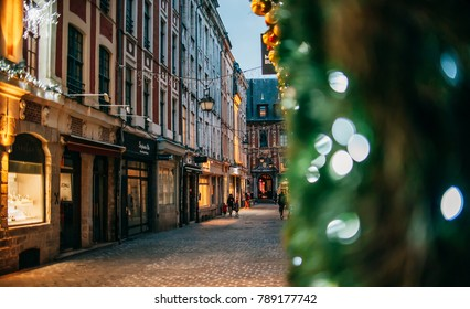 LILLE, FRANCE - January 2, 2018: Night view on the small streets in city center with christmas decorations