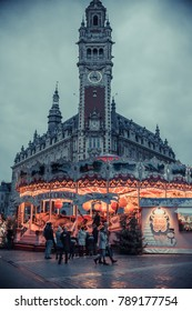 LILLE, FRANCE - January 2, 2018:  A carousel in front of the antique buildings in the city center