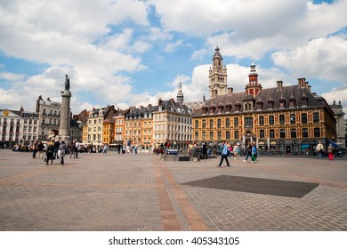 LILLE, FRANCE - JUNE 15: People passing Central town square, La Grand Place in Lille in afternoon on June 2015