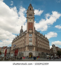 LILLE, FRANCE - JUNE 2018: Tourists walking at the old shopping street of Lille, wide view to the Chamber of Commerce and Industry Grand Lille (Chambre de Commerce et d'Industrie Grand Lille), France.