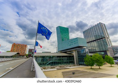 Lille, France - June 3, 2015: Modern architecture railroad station Lille Europe with its easyily recognizable shape, EU flag hanging