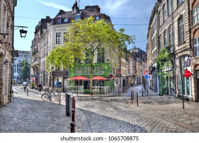 Lille, France - May 29, 2017: People sit at cafes in the old part of Lille, France on May 29, 2017