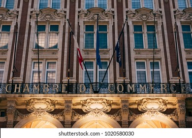 LILLE, FRANCE - NOVEMBER 11, 2017: Facade of Chamber of Commerce and Industry in Lille, France. Towering at 76 meters high, the belfry represents the power and the might of European market cities.