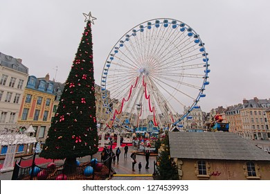 LILLE, FRANCE, NOVEMBER 25, 2018, Big christmas tree and ferris wheel on a square in the city of Lille, 25 November 2018