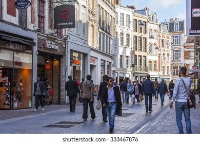 LILLE, FRANCE, on AUGUST 28, 2015. Urban view. People go by the shopping street in the bright sunny day.