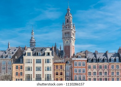 Lille, old facades in the center, the belfry of the Chambre de Commerce in background