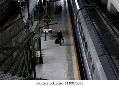 Lille,France Nov. 19, 2016. A passenger walks on a platform after a commuter train arrived at Gare de Lille railway station.