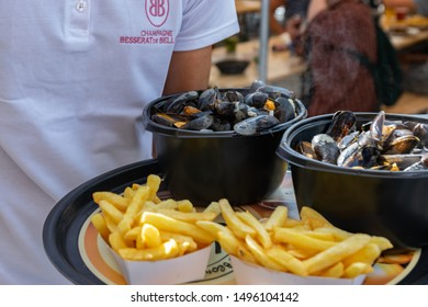 Lille,FRANCE-September 01,2019: Great Lille Braderie (Braderie de Lille).Traditional dish on Lille Braderie, mussels and fries (moules frites).