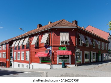 Lillehammer, Norway - August 5 2018: Corner supermarket in a red wooden building