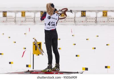 LILLEHAMMER, NORWAY – JANUARY 28: Woman firing rifle during the Statkraft biathlon tournament organized by the Norwegian Biathlon Association on January 28, 2012 in Lillehammer, Norway.
