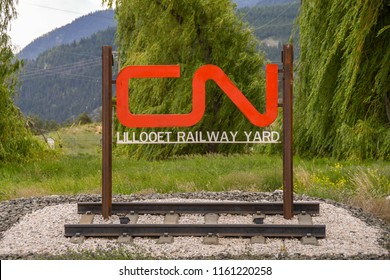 LILLOOET, BRITISH COLUMBIA, CANADA - JUNE 2018: Rail company logo mounted on a metal frame above a track at the entrance to a railway year in Lillooet, Canada,