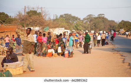 LILONGWE, MALAWI - SEPTEMBER 04 2009: A typical busy roadside in Malawi, lined with colorful people and traders of all types. Many Malawians run basic trade businesses along the rural roads.