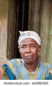 LILONGWE, MALAWI - SEPTEMBER 04 2009: An African Malawian woman dressed in clothing made from bold, colorful traditional cloth. Hair scarves are part of their traditional dress.