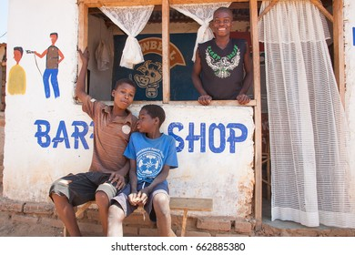 LILONGWE, MALAWI - SEPTEMBER 05 2009: A rural barber shop near Lilongwe in Malawi. Local entrepreneurs run their small trades from dilapidated brick buildings.